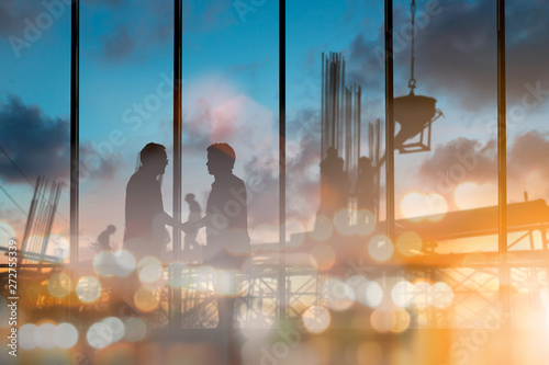 Obraz abstract bokeh background glitter and vintage lights background over Silhouette of engineer and construction team working at site. The party celebrating the success of important projects - fototapety do salonu