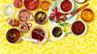 Leinwandbild Motiv Overhead view of chutney and salsa in bowls