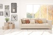canvas print picture - Stylish room in white color with sofa and autumn landscape in window. Scandinavian interior design. 3D illustration