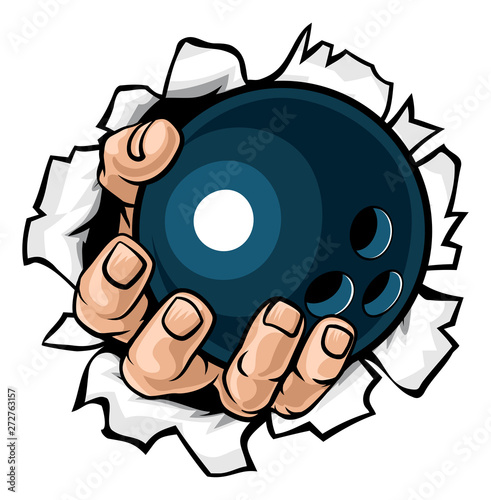 Photo  A strong hand holding a bowling ball tearing through the background