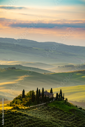 Tuscany landscape at sunrise. Typical for the region tuscan farm Fotobehang