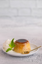 Creme Caramel Dessert Or Flan  Decorated  With Whipped Cream And Mint  . Sweet Moment Vertical Background.