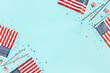 canvas print picture - 4th of July American Independence Day decorations on blue background. Flat lay, top view, copy space