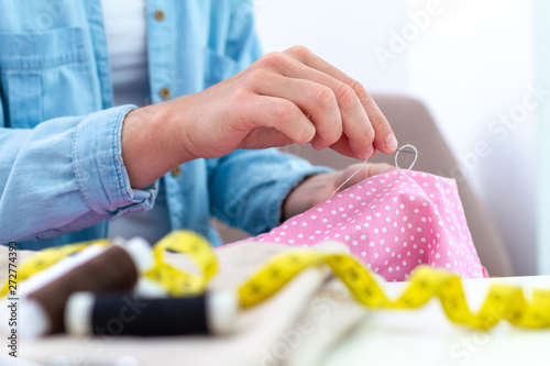 Fotografiet  Sewing process