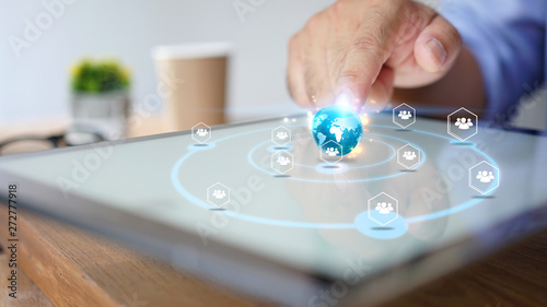 Fototapeta Businessman using tablet. World connected, social network concept obraz