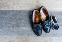 Loafer Shoes And Shoe Polishing Equipment.Brush And Shoe Polish On Vintage Wood