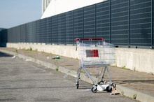 Abandoned And Empty Shopping Cart.