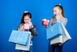 canvas print picture - Shopping day. Children bunch packages. Kids fashion. Girls sisters friends with shopping bags blue background. Every product delivered to you. Shopping and purchase. Black friday. Sale and discount