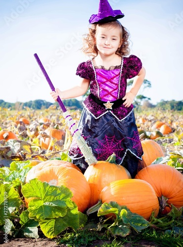 Stampa su Tela Happy Halloween! Cute cheerful little witch with a magic wand