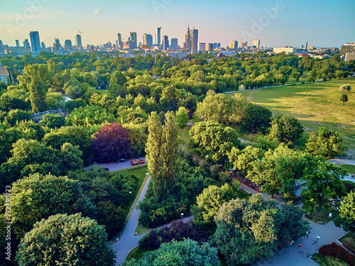 Fototapeta A beautiful panoramic view of the sunset in a fabulous evening in June from drone at Pola Mokotowskie in Warsaw, Poland -