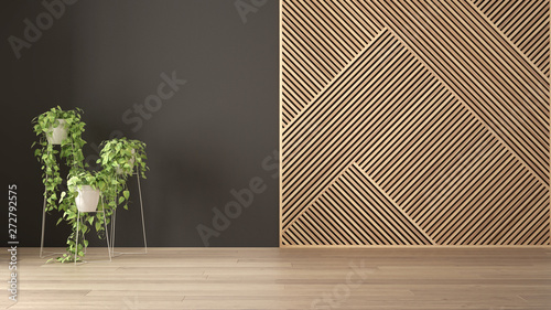 Empty room with wooden panel and potted plant, parquet floor