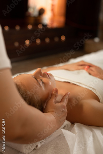 Poster Spa Attractive blonde lady peacefully lying on a matrass covered in white blanket