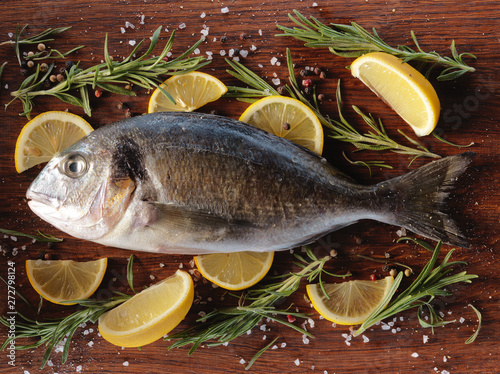 Poster Fish Raw dorado fish with rosemary and sea salt