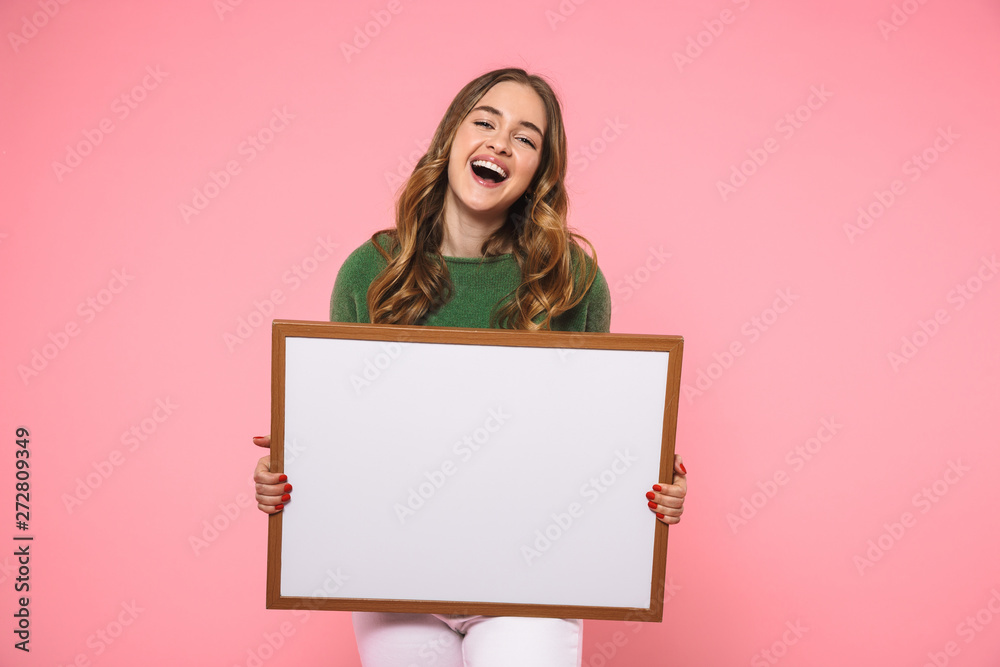 Fototapety, obrazy: Laughing woman holding blank board and looking at the camera