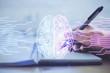 Leinwandbild Motiv Double exposure of writing hand on background with brain hologram. Concept of learning.