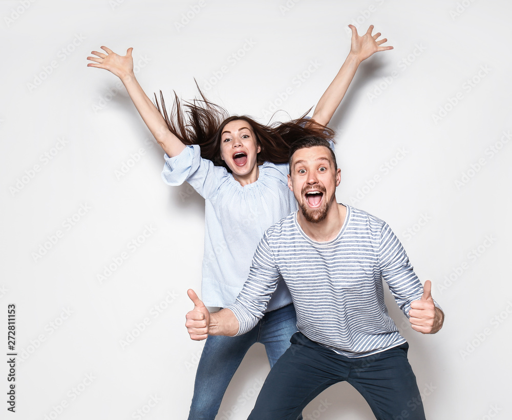 Fototapety, obrazy: Happy young couple on light background