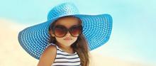 Summer Portrait Fashionable Little Girl In Straw Hat, Sunglasses On Beach Near Sea