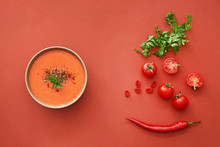 Bowl Of Tasty Cream Soup And Ingredients On Color Background