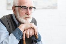Sad And Bearded Senior Man Wit...