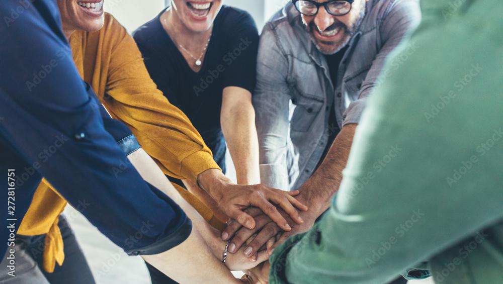 Fototapeta Business team making a stack of hands