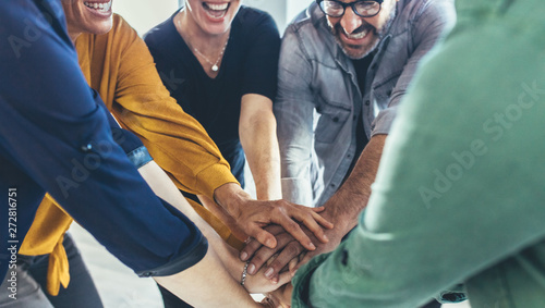 Business team making a stack of hands - 272816751