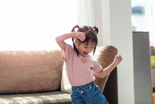 Happy Asian Child Having Fun And Dancing In A Room