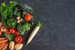Healthy vegetables on dark background