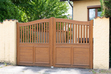 Brown Wooden Gates Of Private House
