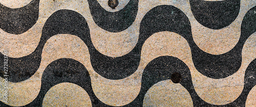 Empty boulevard sidewalk wave pattern of cobblestones of Copacabana beach at early morning sunrise in Rio de Janeiro Wallpaper Mural