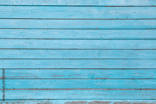 Foto  texture wooden background with old cracked blue paint