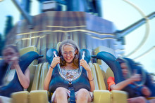 Young Friends Have Fun In The Park. Happy Guys Ride On Attractions. Entertainment Park, Amusement, Sky Thrill