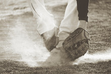 Baseball Player Fielding Grounder Ball In Field Dirt, Action Shot With Vintage Sports Style.