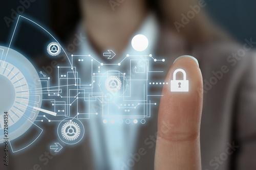 Businesswoman pressing control glass of biometric fingerprint scanner, closeup Wallpaper Mural