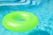 Leinwandbild Motiv Bright inflatable ring floating in swimming pool on sunny day
