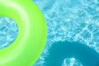 Leinwandbild Motiv Bright inflatable ring floating in swimming pool on sunny day. Space for text