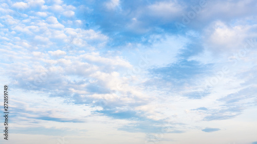 sky with white and gray clouds in summer evening