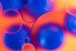 canvas print picture - oily drops in water with colorful background, close-up