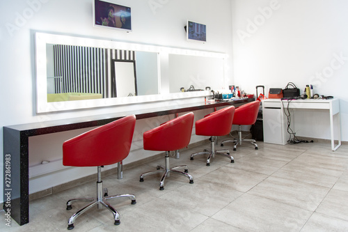 Bright dressing room with red chairs Fototapeta