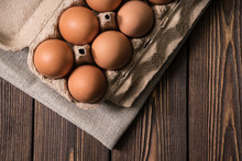 Chicken Eggs On The Wooden Table Background