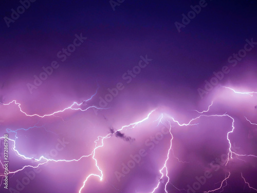 Foto op Canvas Onweer Lightning thunderstorm flash over the night sky. Concept on topic weather