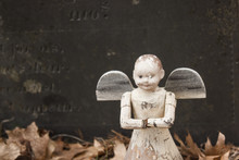 Old Angel Toy On A Child's Grave