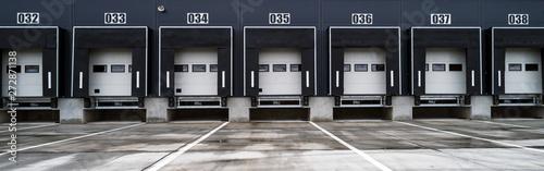 Big distribution warehouse with industrial doors for loading dock trucks Wallpaper Mural