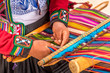 Leinwanddruck Bild - Peruvian woman working on traditional handmade wool production
