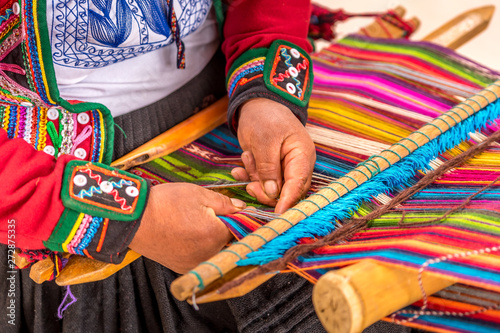 Peruvian woman working on traditional handmade wool production Canvas Print