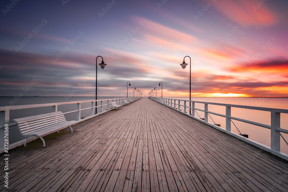 Fototapety, obrazy: Wooden pier in Gdynia Orlowo in the morning with colors of sunrise. Poland. Europe.