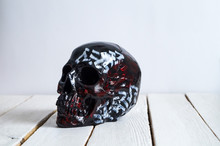 Skull On The White Wall And Wood Background