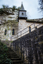 Stairs Climbing Up To A Traditional Church Building Built Into The Rock Walls By Pont Adolphe In Luxembourg City, Luxembourg