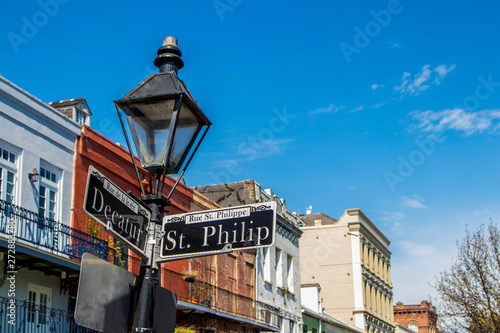 Classic Colonial Buildings Stand out behind a Lamppost on the Corner of Decatur and St Canvas Print