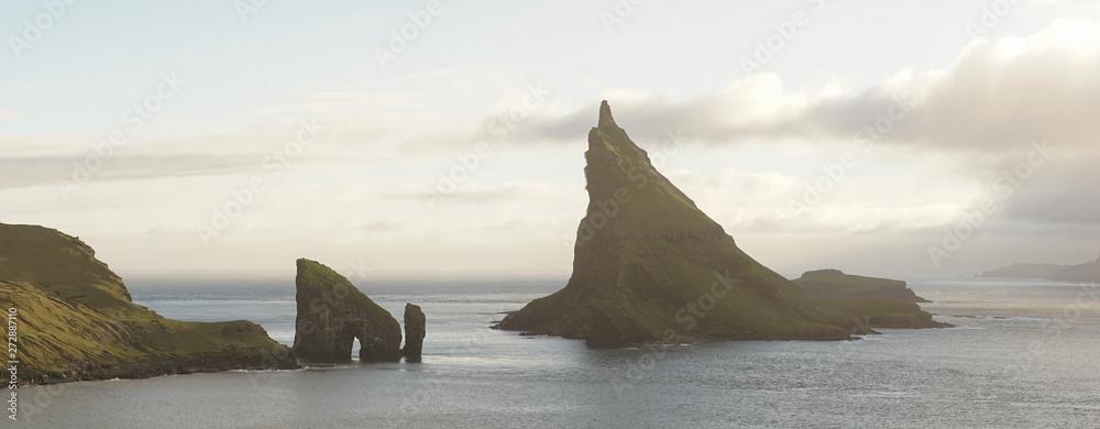 Fototapety, obrazy: Drangarnir Sea Stack Mountain Hike near Sorvagur during sunset on the Faroe Islands in the Atlantic Ocean.