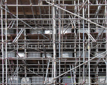 Scaffolding On A Construction Siteshowing Ibc Water Filled Intermediate Bulk Containers Used As Ballast On Each Level